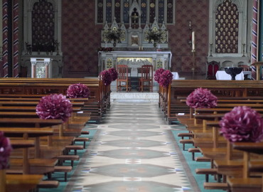 Altar flowers and burgundy paper pompoms