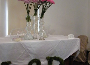 Altar flowers and moss letters