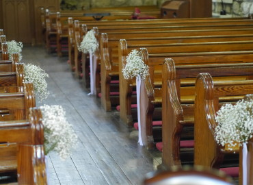 Baby's breath with satin ribbon on pew ends