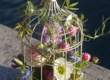 Birdcage with summer flowers