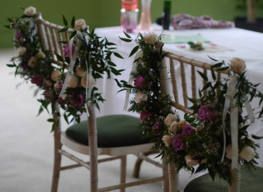 Bridal chairs flower swags