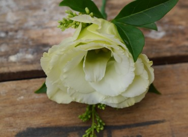 Bright green boutonniere