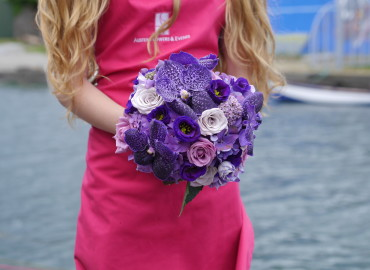 Purple rose & orchid bouquet