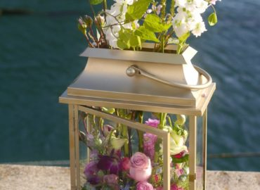 Hurricane lantern with flowers