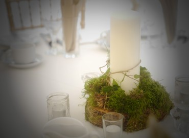 Mossed candles on wood slices