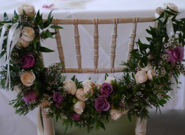 Swag of roses waxflowers and ruscus