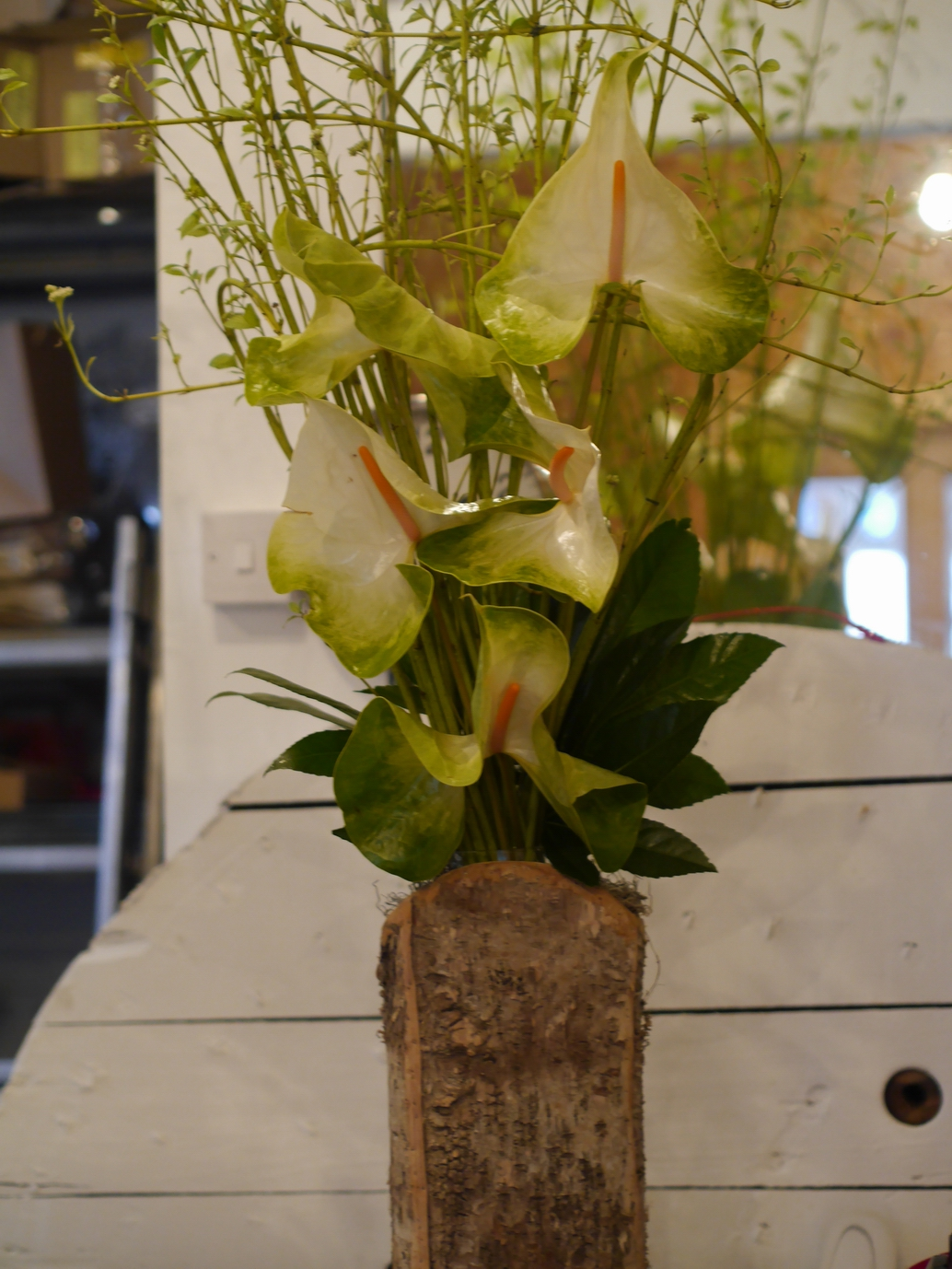 Bark vessel and tropical flowers
