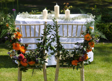 Pop Of Orange Wedding - wedding chairs and celebration table