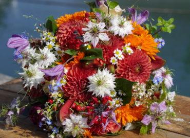 Pop Of Orange Wedding - Brides Bouquet of flowers hand tied with jute