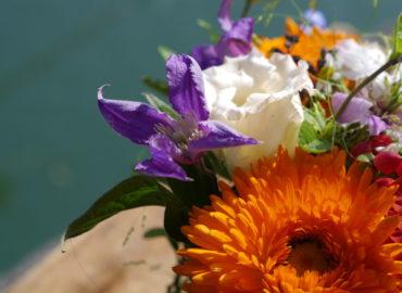 Pop Of Orange Wedding - Detail of bride's bouquet