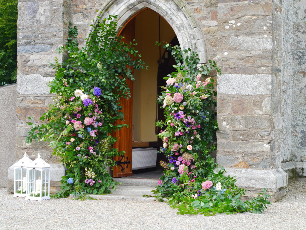 Church entrance flowers for a Marlfield wedding